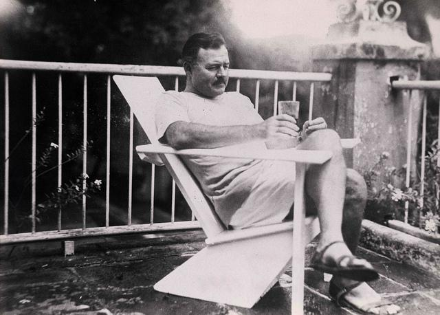 Creativity is Problem Solving - Ernest Hemingway Sitting in a Chair